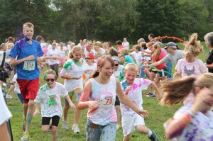 "Kids and adults alike are doused with color during the ""Color Corridor"" Fun Run before the 2012 Color Splash 5K."
