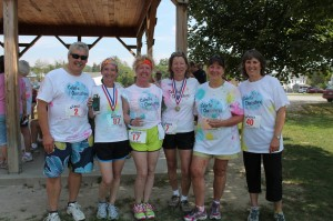 "Team ""Colorful Characters"" poses for a photo-op following the awards ceremony at the 2012 Color Splash 5K"